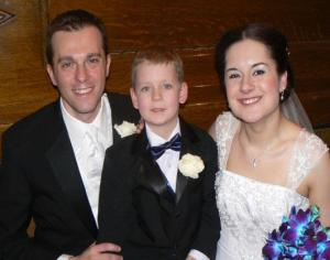 Dan & Rachel with our five-year-old Braedon, who served as the dashing ring bearer.